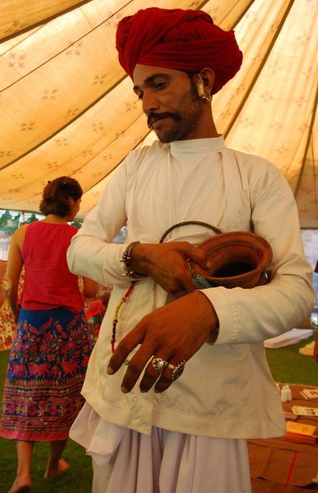 raika with camel milk container